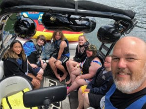Picture from Camp Attitude -group shot on a boat